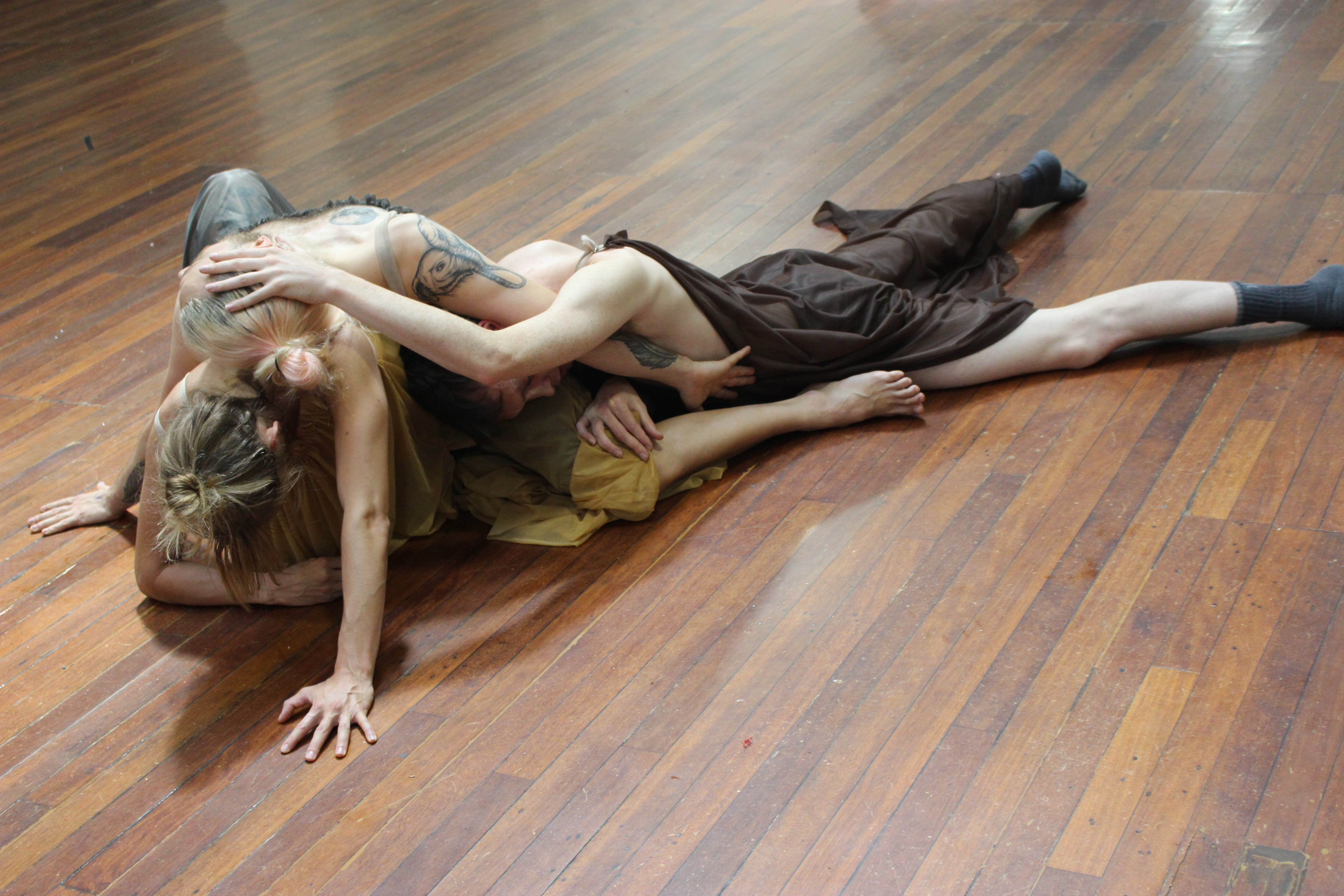 2018.<br> In chorus costume, Tilly, Joshua, Lenny, and Alessandro work on a series of poses to be interspersed throughout a mechanical Nations sequence. Alessandro, who lead the rehearsal, moulded and positioned the dancers such that their limbs were layered and distorted, echoing and displacing the violence played out between the Nations.