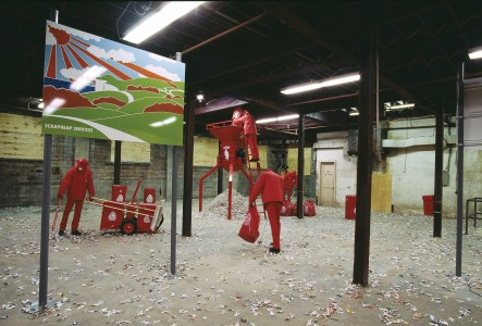 Walker Art Center, Minneapolis, 22 Oct. 1995–7 Jan. 1996, showing Michael Landy, <i>Scrapheap Services</i>, 1995, mixed media installation with customized chipper/shredder; two silk-screened baked enamel street signs; five mannequins with standardized uniforms; seven trash bins; trash bin carrier, dimensions variable