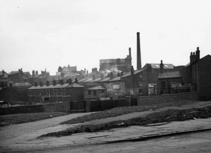 <i>view of slum clearance land corner of Palmerston Street, showing back of terraced houses on Pin Mill Brow and property facing Ashton Old Road, 1960s</i>. Collection of Manchester Libraries.