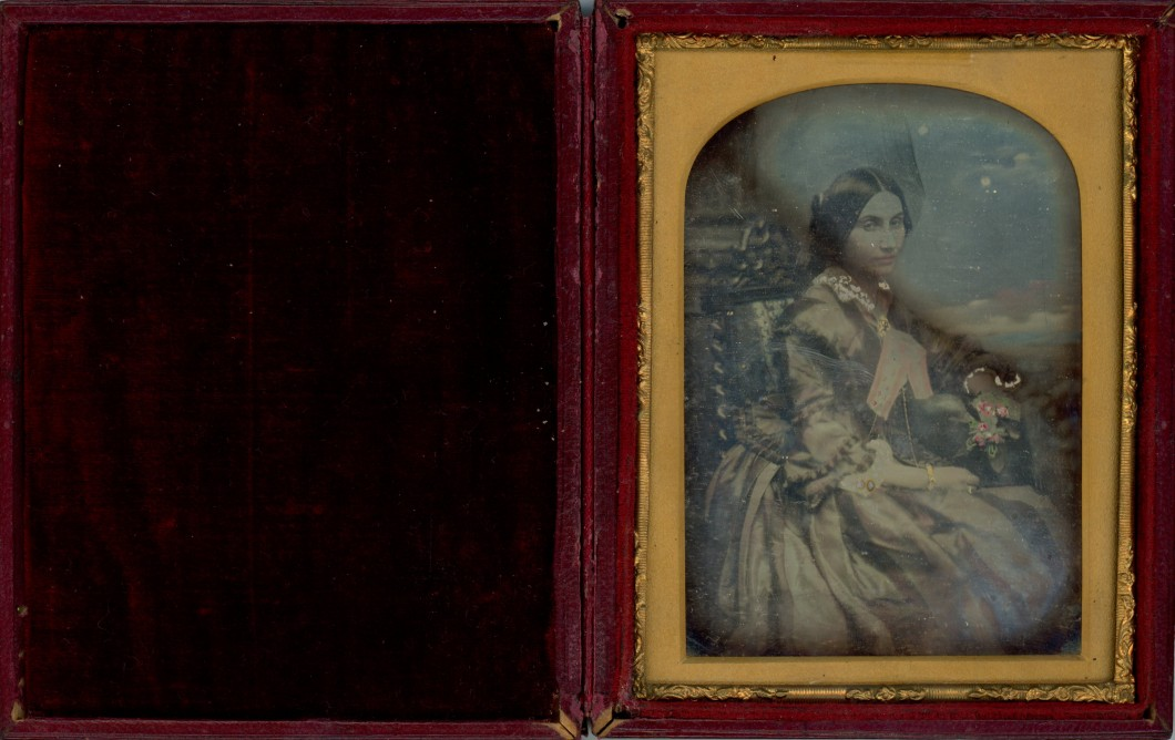 Portrait of Ann Elizabeth Griffith (showing photograph in case)