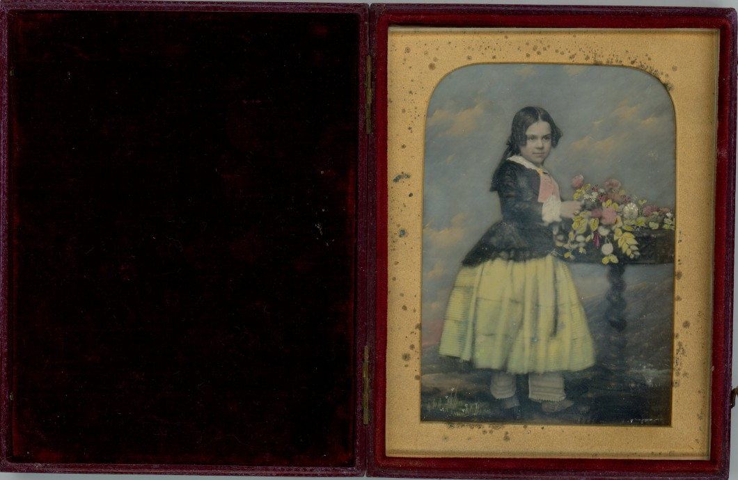 Portrait of a Girl with Flowers (showing photograph in case)