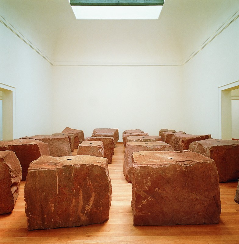 1990, showing Anish Kapoor, <i>Void Field</i>, 1989, 16 elements, sandstone and pigment, each element 125 x 125 x 125 cm
