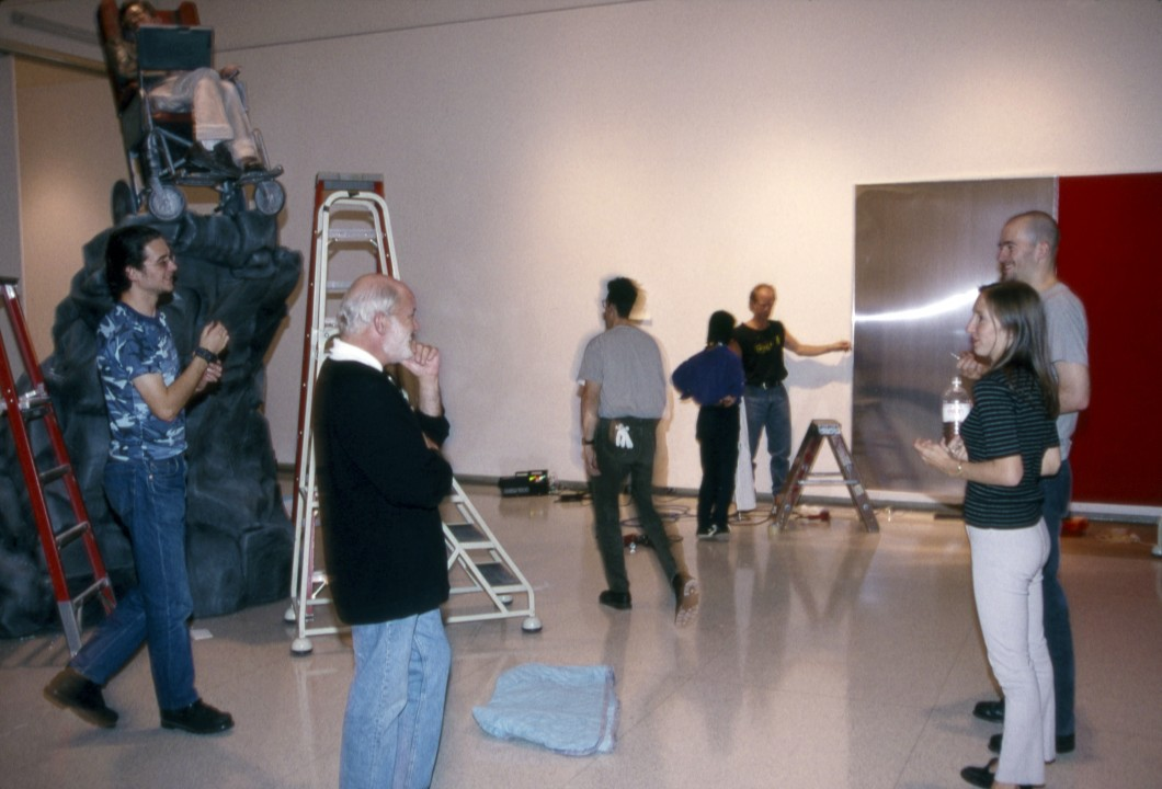 view during the installation of at the Walker Art Center, Minneapolis, Oct. 1995, showing (from left) works by Dinos Chapman, Richard Flood, Sam Taylor-Wood, and Jack Chapman