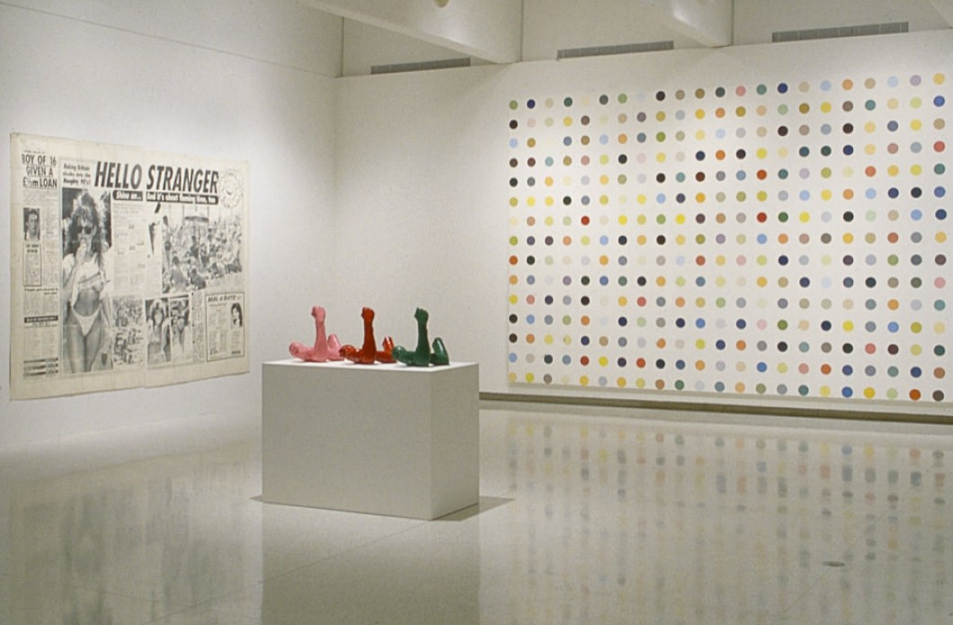 "Walker Art Center, Minneapolis, 22 Oct. 1995–7 Jan. 1996, showing, left to right: Sarah Lucas, ""Hello Stranger"" (part of <i>Shine On</i>), 1991, Damien Hirst, <i>Alphaprodine</i>, 1993"