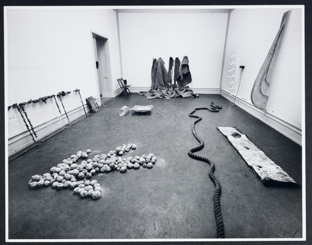 1969, showing clockwise from left: Mario Merz, <i>Appoggiati</i>, 1969, Mario Merz, <i>Sit-in</i>, 1968, Richard Artschwager, <i>Blp</i>, 1968, Robert Morris, <i>Felt</i>, 1967, Bruce Nauman, <i>Neon Templates of the Left Half of My Body Taken at Ten Inch Intervals</i>, 1966, Bruce Nauman, <i>Untitled</i>, 1965, Bruce Nauman, <i>Collection of Various Flexible Materials Separated by Layers of Grease with Holes the Size of My Waist and Wrists</i>, 1966, Barry Flanigan, <i>Two Space Rope Sculpture</i>, 1967, Alighiero Boetti, <i>lo che prendo il sole a Torino il 19 gennaio 1969</i>, 1969