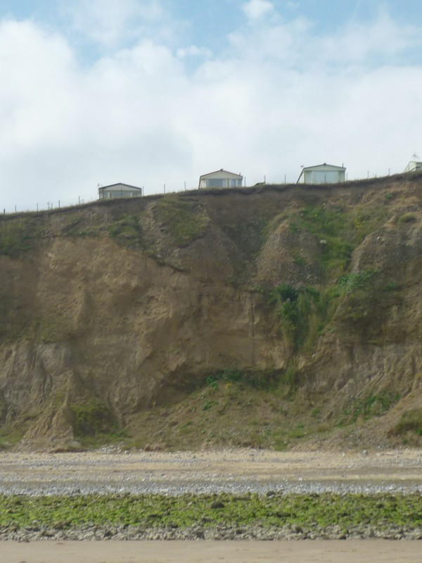 Seaview caravan park viewed from East Runton beach at low tide, Norfolk