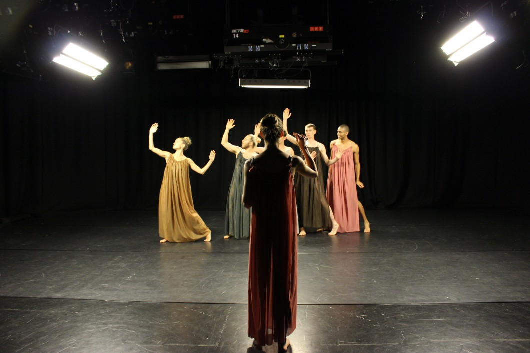 "2018. Roseanna directs the dancers as they run their second Chorus number. The black box studio heightened the effect of the lighting, with one dancer remarking that the footage looked like a ""moving Caravaggio"". The chiaroscuro created by such strong, directed light accentuated the musculature of the dancers, linking back to Maxwell Armfield's illustrations."