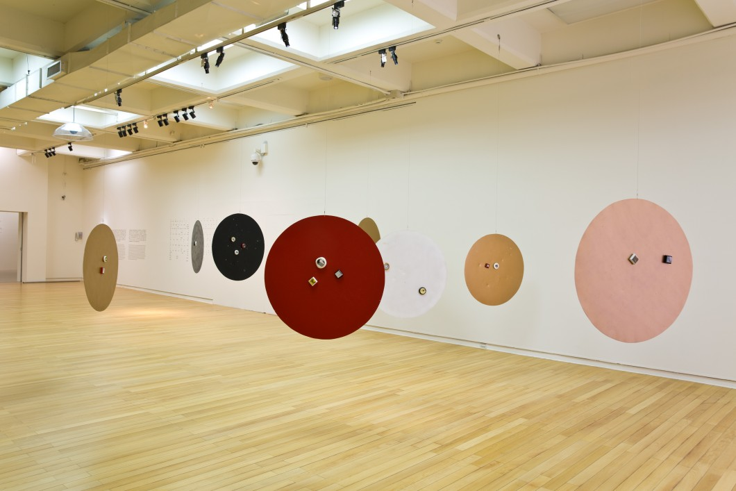 Circular sculptural forms installed in exhibition space