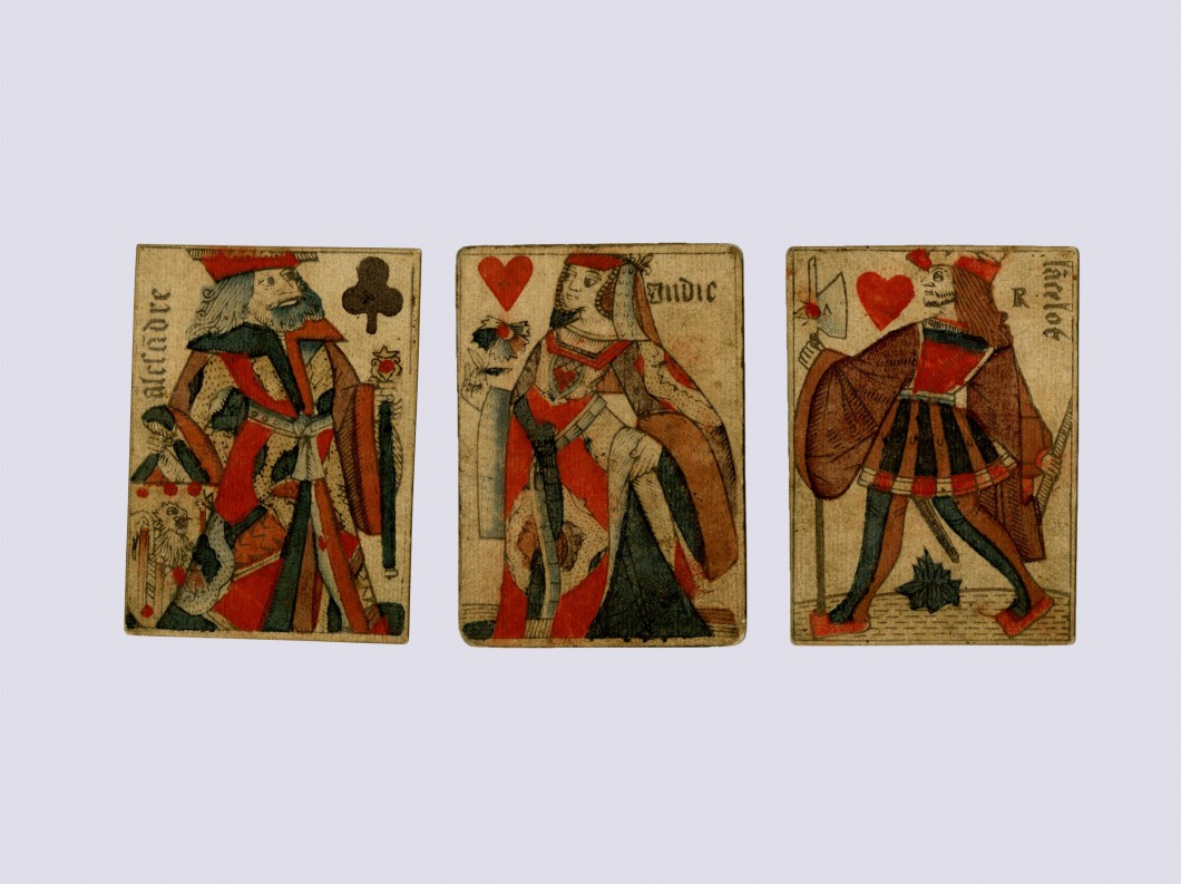 Three court playing cards with French suit marks (the cards are the knave and queen of hearts and the king of clubs)
